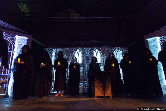 Cosmic Trigger - The stage is filled with actors dressed as a black mass