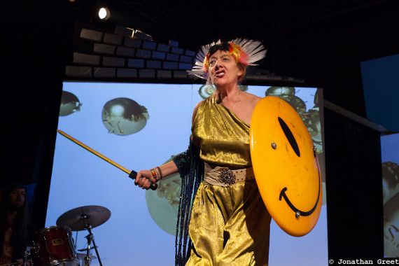 Cosmic Trigger - Actress dressed as a goddess with a sword and shield