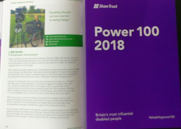 A photo of the power 100 book, with MIk's page open too