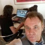 MiK Scarlet & 5 News editor editing news item