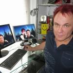 Mik Scarlet sitting at his desk