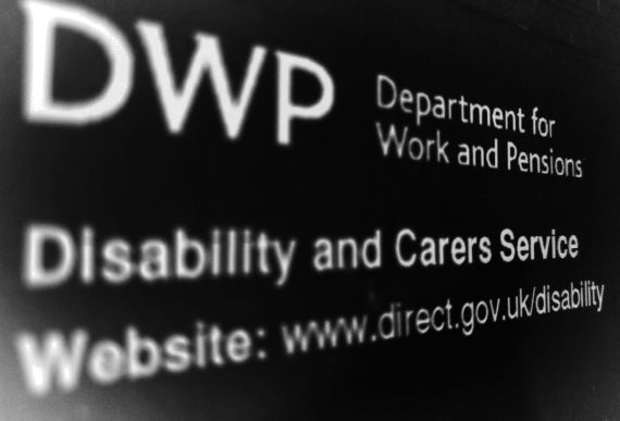A negative image of a letter from the DWP, informing of a PIP reassessment